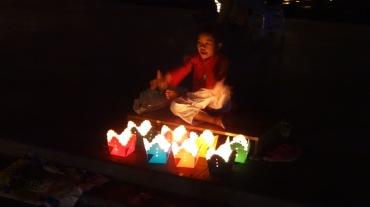 Child selling floating lanterns