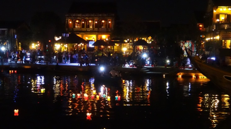Colourful paper lanterns floating on the river.